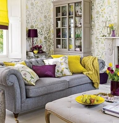 Gray/Yellow/Purple living room. Not sure about the wall paper but the pillow color combination is cool.
