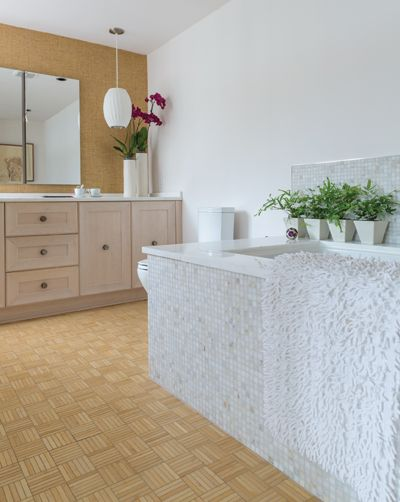 Parquet Bamboo Tile FooringShowing a tall tiled in tub too.