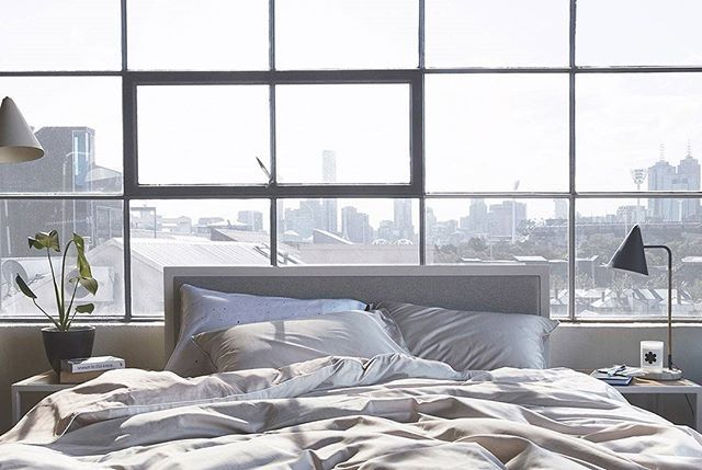 Sun soaked, morning cushiness courtesy of our East Village quilt ✖️upholstered Oliver bed ☁️☁️☁️ #goodmorning #loftlife #cityview #eastvillage #bedroombliss