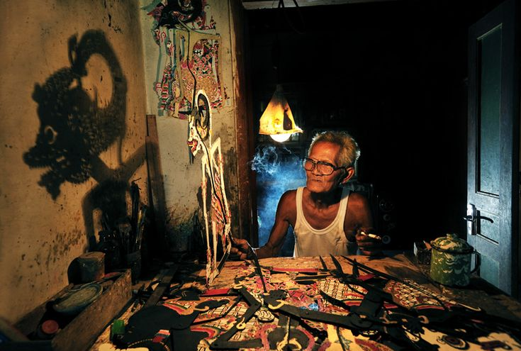 Shadow Puppet Craftsman.  City of Solo, Java, Indonesia.
