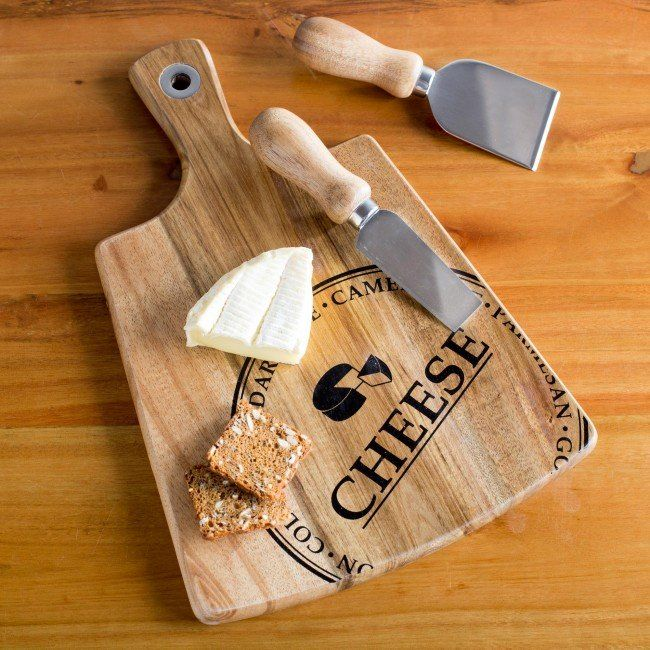 Cut, slice and serve your favourite cheese and crackers on our durable and attractive Artisan Paddle Board. Rich and beautiful acacia wood has an elegant grain that looks great with any decor and includes two stylish cheese knives with matching acacia wood handles.
