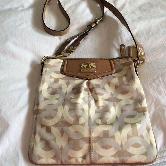 Coach swingpack purse, gold, cream, & gray cloth Authentic Coach purse. Gold, cream & gray cloth swingpack cross body  purse in good condition, its only been used a 1/2 doz times Coach Bags Crossbody Bags