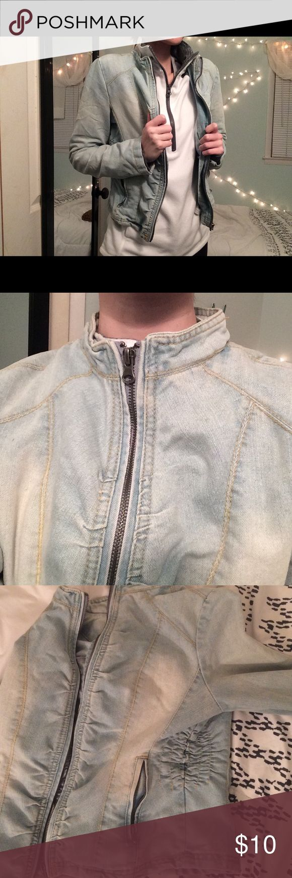 """Zip-up Jean Jacket Light wash denim zip up jacket. 65% cotton. 31% polyester. 4% """"other""""... Features zip up pockets and also zip up cuffs. BONGO Jackets & Coats Jean Jackets"""