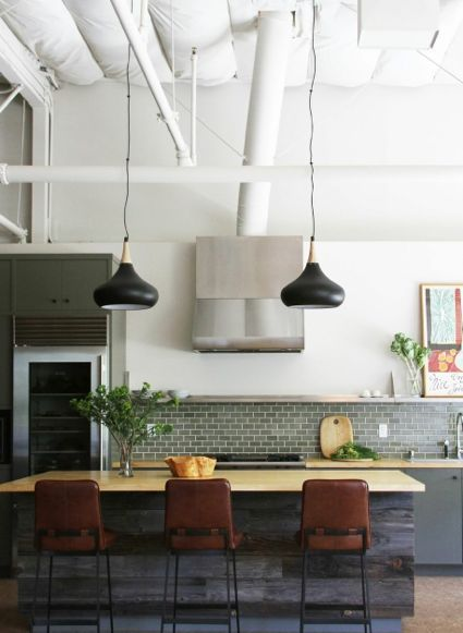 .green/grey metro tiles, stainless shelf, stainless wall of units, recycled timber island, pendant lamps over
