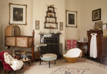 The Day Nursery with a mahogany and wicker cradle and a collection of Victorian toys at Arlington Court, Devon