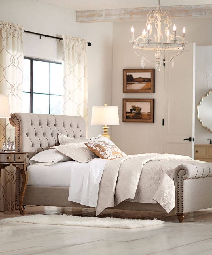 Your bed is the most important part of your bedroom. Choose one that's elegant and timeless. Available in either beige or grey, this sleigh bed is the perfect backdrop for beautiful bedding. Diamond tufting and brass nailheads give it an extra special design. Check out this bedroom style favorite. Available at Home Decorators Collection.