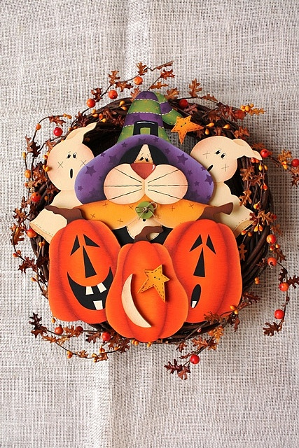 Cat on Pumpkins by fiore_labs, via Flickr