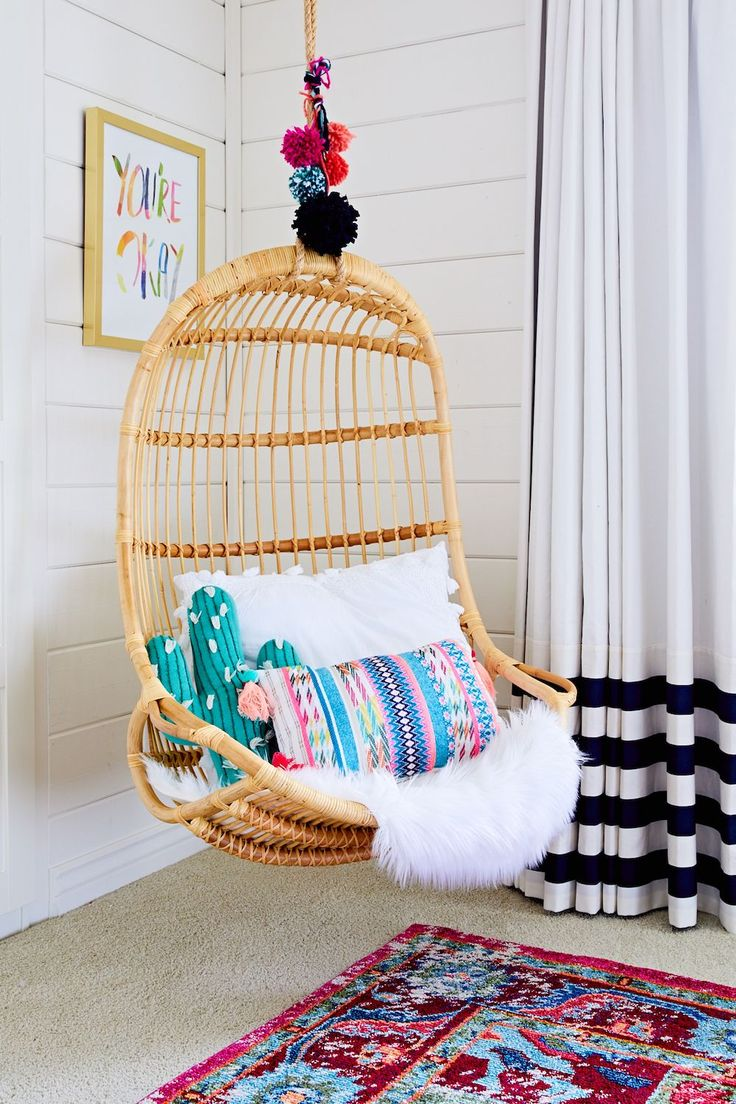 Boho Chic Girl's Room with Hanging Rattan Chair | Image via Project Nursery