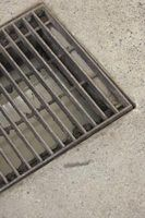 A trench drain can resolve the problem of standing water at the low point of a driveway.