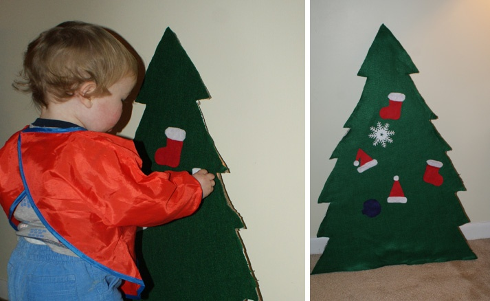 Felt Christmas Tree. Needs a few more decorations, but it is a good alternative to pulling all of the ornaments off of the real tree. Cost about 3 dollars to make.
