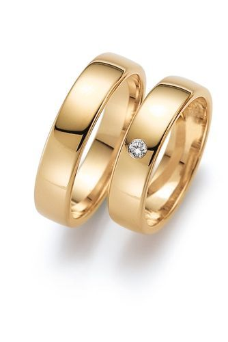 Obrączki ślubne z żółtego złota z brylantem o masie 0,05 ct. Próba 0,585