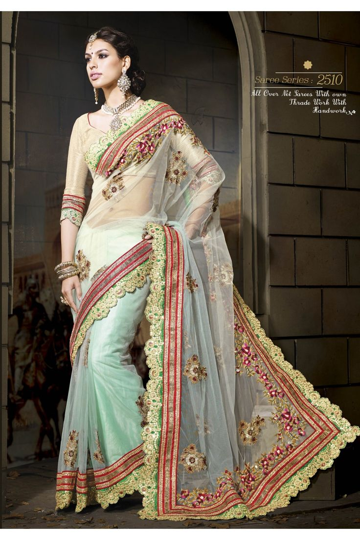 Light Mint Net Saree :- Net Saree in light mint green is beautifully adorned with Zari embroidered motifs all over the Saree. A resham embroidered floral patterns runs along the pallu. The Saree is enclosed with Zari gota borders on a red base and hand embroidered sequins and Zari designed lace border over green base that runs on the edges of the Saree. The Saree is teamed with a Designer blouse in golden.