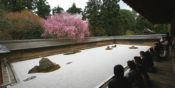 """Ryoanji Temple (龍安寺, Ryōanji) is the site of Japan's most famous rock garden, which attracts hundreds of visitors every day"""