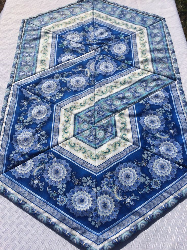 Quilted Table Runner Triangle Frenzy Hexagon Table Topper by Heathersquaintquilts on Etsy https://www.etsy.com/listing/218325858/quilted-table-runner-triangle-frenzy