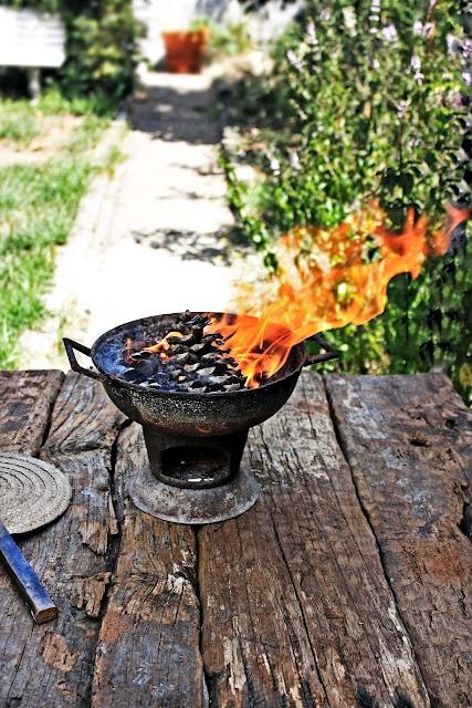 Lighting the fogareiro (traditional portuguese grill)