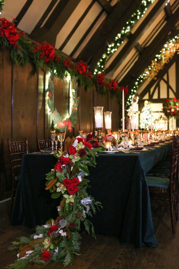 Cascading, Holiday-Inspired Floral Runner with Foliage | Photography: Robyn Rachel Photography. Read More: http://www.insideweddings.com/weddings/christmas-theme-wedding-with-festive-red-green-decor-in-illinois/729/