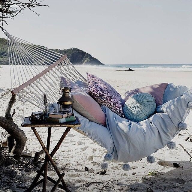 Cosy hammock on the beach. Want to take a nap in these cushions?