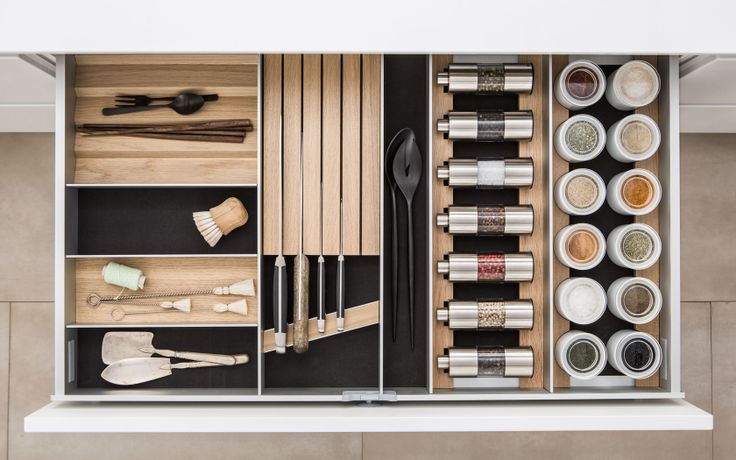 A unique mix of spices and tools, and a unique mix of materials from SieMatic: high-quality aluminum, velvety flock, fine porcelain, and fine woods like dark smoked chestnut or light oak with numerous innovative functions.