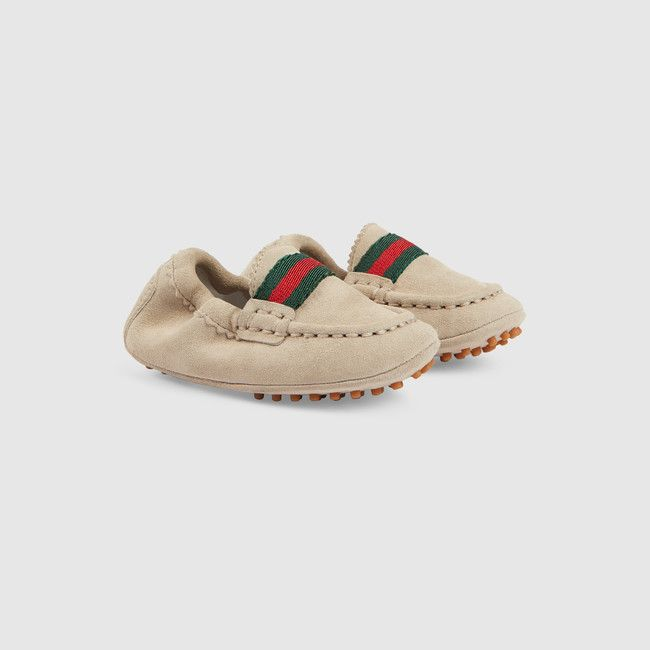 Gucci Baby sand suede driver with green/red/green web detail, a pebbled sole, and elasticized back.