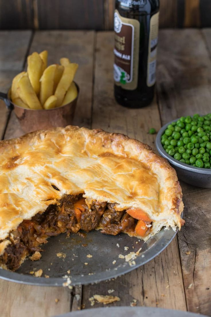 British Steak and Ale Pie is a British classic found at most pubs around England. Serve it with pea and chips for a perfectly comforting meal.