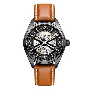A sophisticated brown leather strap watch from Hamilton. Showcasing a skeleton dial with rose gold tone Arabic Numbers , set in a black ion-plated case for a contrasting finish.