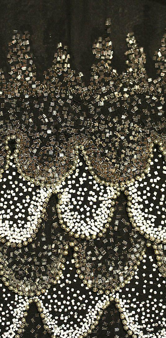 Vermicelli tambour beadwork on a ca. 1926 silk evening dress.