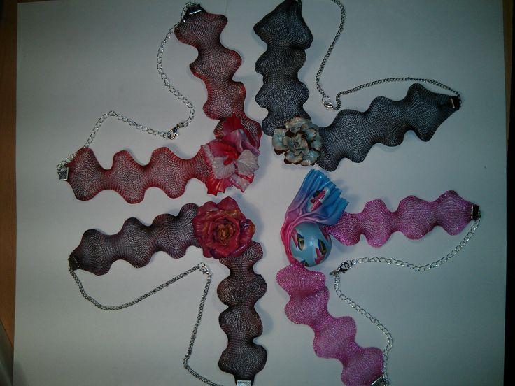 Hand made polymer clay pendants on metal mesh.  https://www.facebook.com/Anna-Donna-%C3%A9kszer-231340573715505/