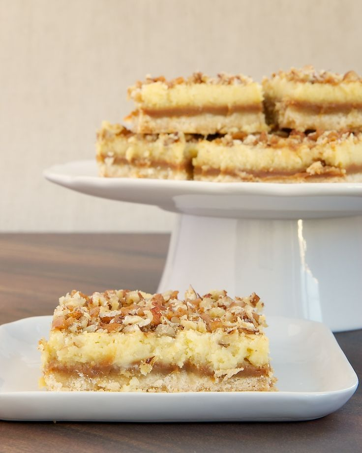 Caramel Cream Cheese Bars feature delicious layers of shortbread, caramel, cream cheese, and nuts.