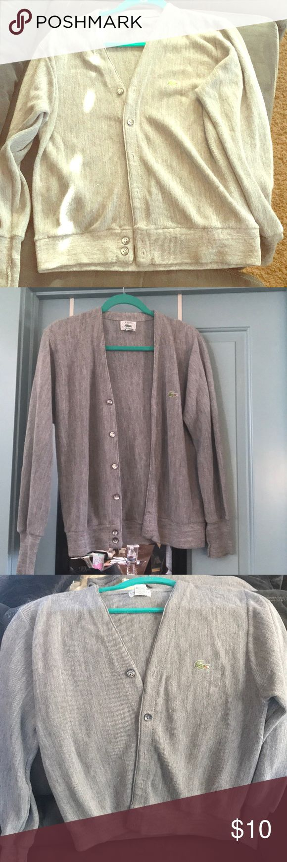Izod Lacoste Cardigan🐊 Super cute vintage Izod/ Lacoste women's Cardigan sweater. Grey color goes with so much! It even has iridescent buttons. Perfect addition to a preppy look. Size Small. Has a couple of very small snag see picture but hardly noticeable. Lacoste Sweaters Cardigans