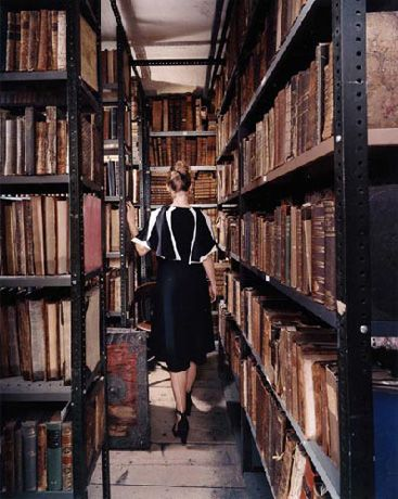 Oddments Room of Maggs Antiquarian Bookshop, Berkeley Square, London, packed with legions of old leather tomes about travel and exploration. Dealers of Rare books and manuscripts since 1853