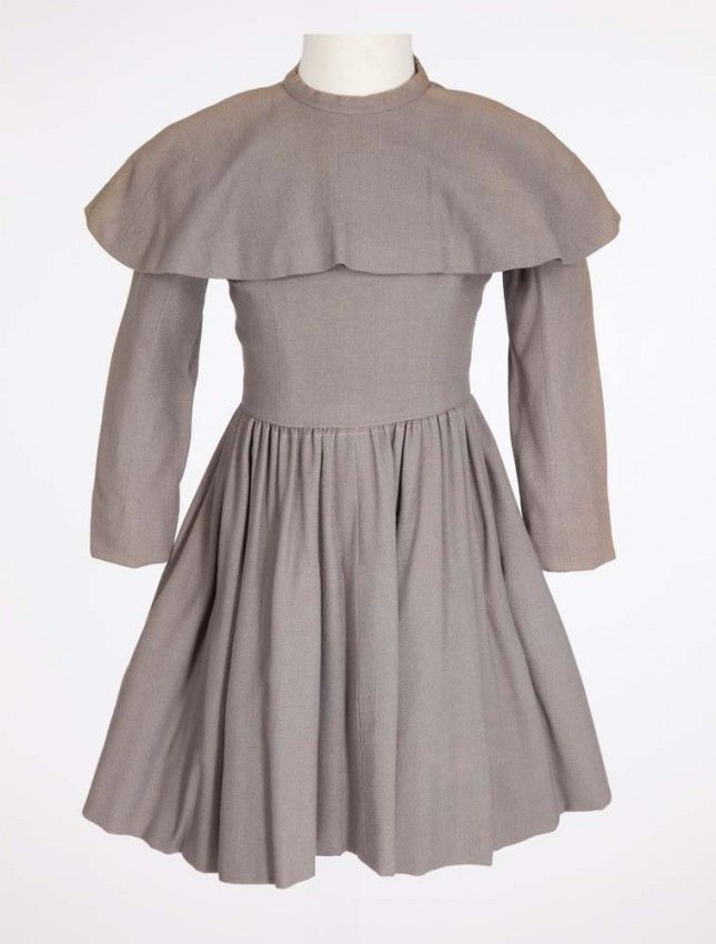 """Peggy Ann Garner """"Younger Jane Eyre"""" grey dress from Jane Eyre. (TCF, 1943) Grey wool crepe dress with self collar. Handwritten label """"394-19 GARNER DOUBLE"""" and stamped """"2 85 1 1177."""" Worn by Peggy Ann Garner as """"the young Jane Eyre"""" when she is attending the Lowood Institution in Jane Eyre."""