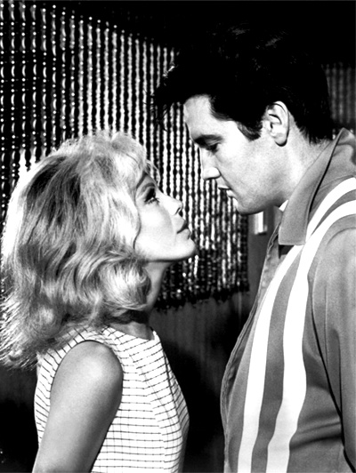 """Susan Jacks (Sinatra) is the IRS agent assigned to keep tabs on Steve and apply his future prize money toward his $150,000 debt, but she ends up taking a romantic interest in him - Elvis and Nancy Sinatra """"Speedway"""""""