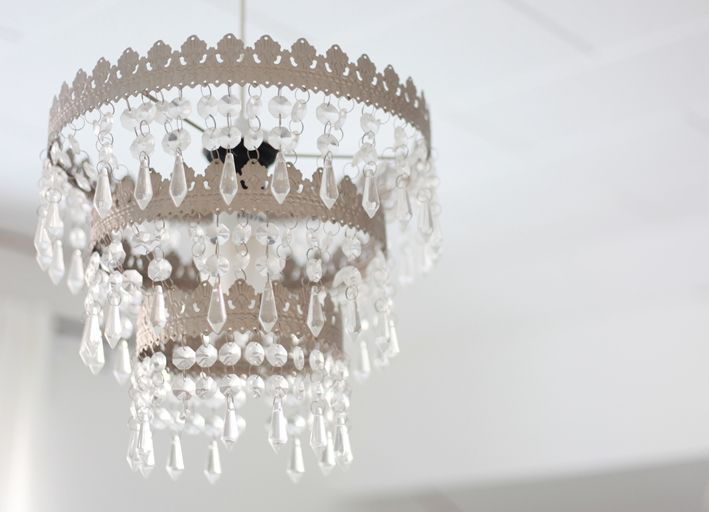 Ikea chandelier. I have two of these hanging in front of an oversized mirror in my bedroom. Love them!