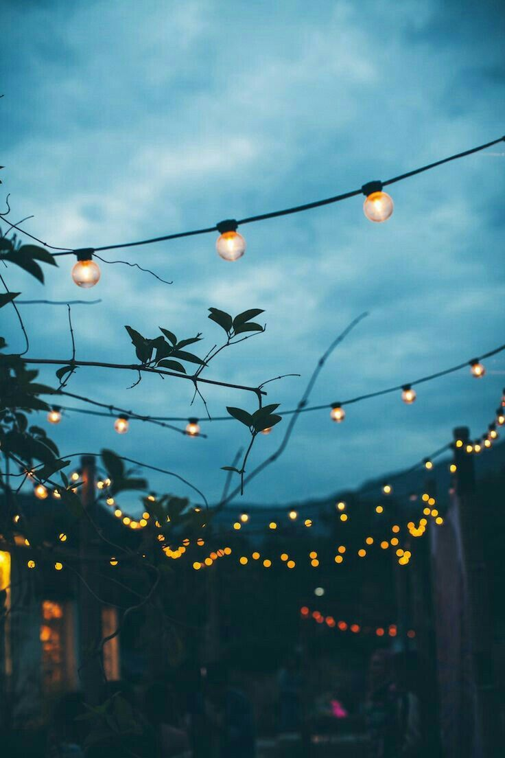 He wandered down the back street behind his house. He looked up at the colourful fairy lights above. Tonight's going to be great, he thought, for the first time in ages.