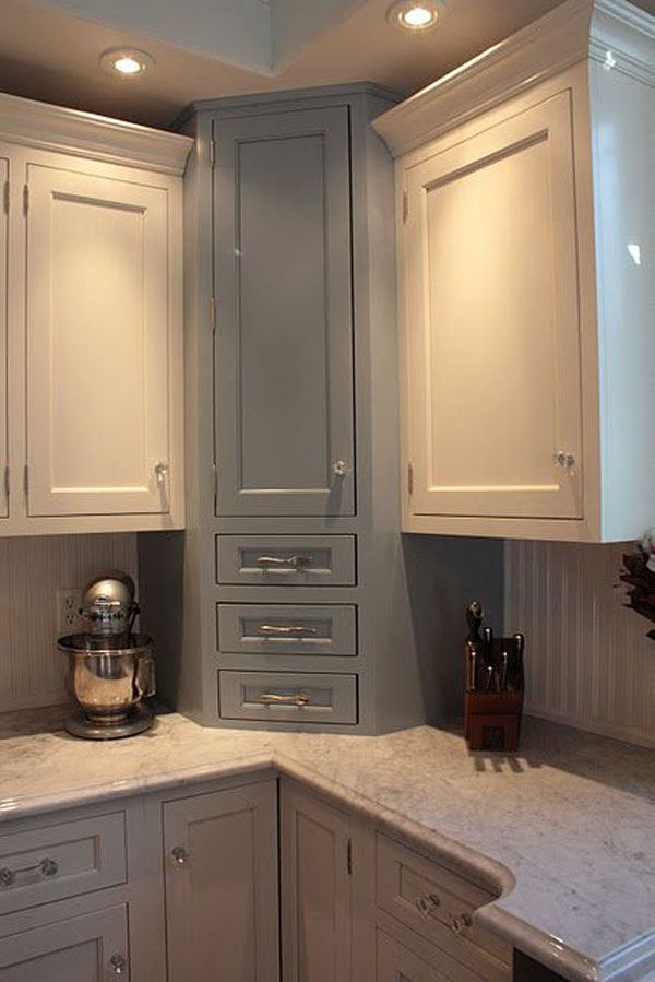 Paint a different color on this corner cabinet which has drawers underneath: Fabulous Hacks to Utilize The Space of Corner Kitchen Cabinets