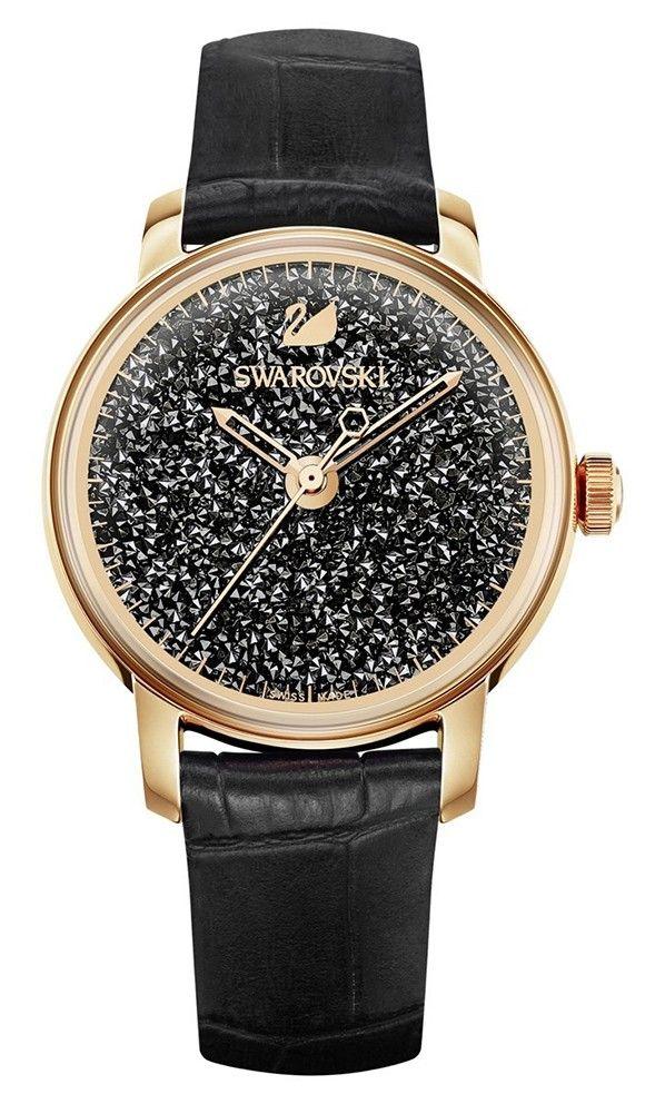 Swarovski Dameshorloge 'Crystalline Hours' Black 5295377. Modieus en speels vormgegeven horloge met 2000 sprankelende, zwarte Swarovski kristallen, die in de rosekleurige kast zijn verwerkt. De kast met een doorsnede van 38 mm heeft een zwarte wijzerplaat met rosekleurige index en wijzers. De zwartlederen horlogeband sluit door middel van een gespsluiting. Het horloge is 50 meter waterdicht en voorzien van een Zwitsers uurwerk. #black #rosegold #swiss #swissmade #horloge…