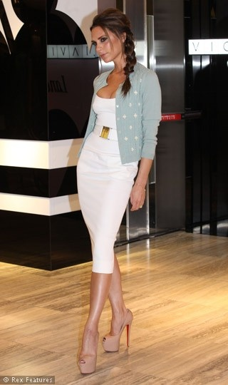 Victoria Beckham.. love the outfit, but the cardigan most
