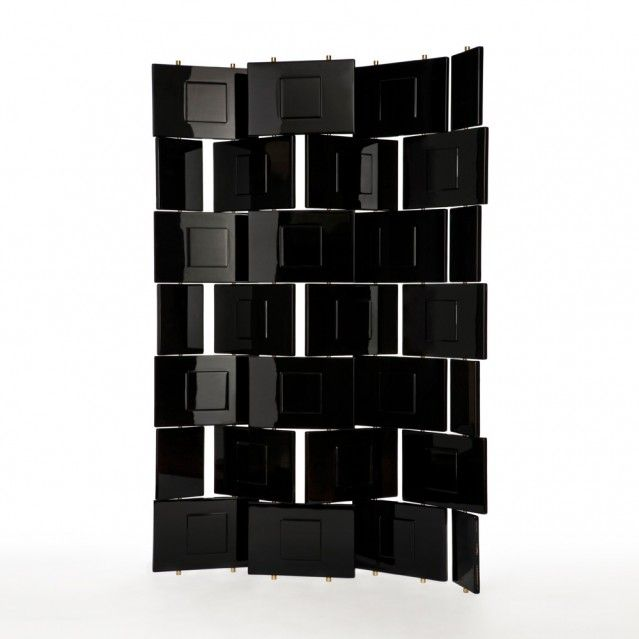 Brick screen divider designed by Eileen Gray in the 1920's in Paris, France. It is constructed with a combination of metals with the addition of a high gloss lacquer finish, and in order to create the perfect finish, it took several weeks to apply the multiple layers of lacquer . This piece is more of a sculpture than a room divider and took immense craftsmanship to produce.   ARAM, Eileen Gray, Brick Screen. [Online] Available at:http://www.eileengray.co.uk/products/brick-screen/