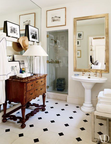 Black/white floor is very French; love the big mirror with the small sink; the wood cabinet adds a nice antique-y touch to the modern shower stall.