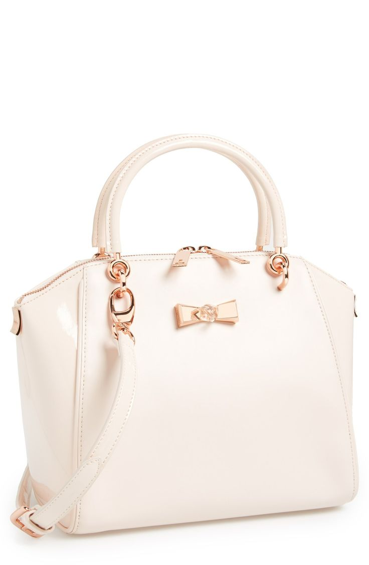 A gem-embellished bow tote in the most gorgeous nude pink color.
