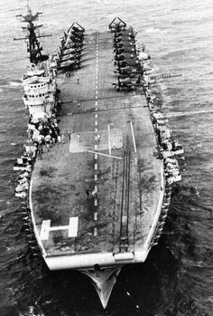 Arromanches underway off French Indochina in the Gulf of Tonkin, Jan 1954; note F6F-5 Hellcat and SB2C-5 Helldiver aircraft on the flight de...pin by Paolo Marzioli