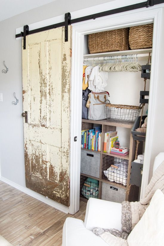 Finally a step-by-step walkthrough on how to install an antique barn door! www.tableandhearth.com
