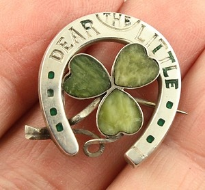 Antique Victorian or Edwardian hallmarked silver Irish Connemara marble ' Dear Little Shamrock' lucky horseshoe brooch. The brooch is stamped ' Dear Little Shamrock ' after the famous irish song of this name by the author Andrew Cherry. The song was written in the late 18th century.  The brooch has a set of hallmarks with makers J.C., the lion for sterling silver, the anchor for Birmingham assay office and a faded date letter which might be a small h for 1907.