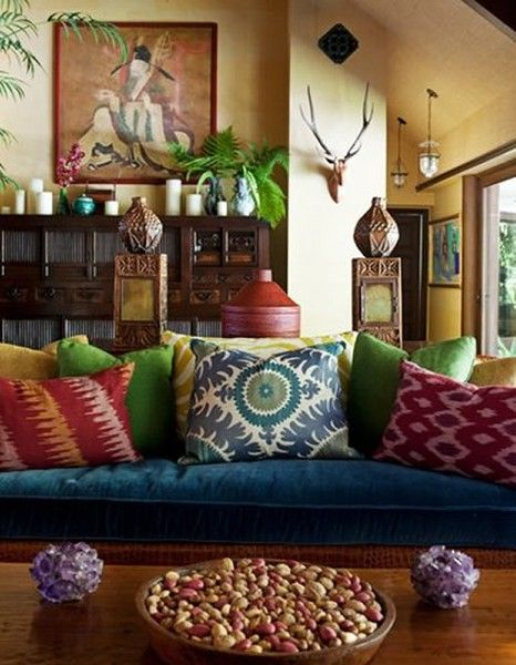 Bohemian style. Always love this with the mix of patterns, blue velvet, neutral wood, asian inspired pieces, ceramics and artwork. The colors are so warm and inviting, you just want to sit down and drink some tea. In love with this style! Especially for a sunroom or social area in the house.