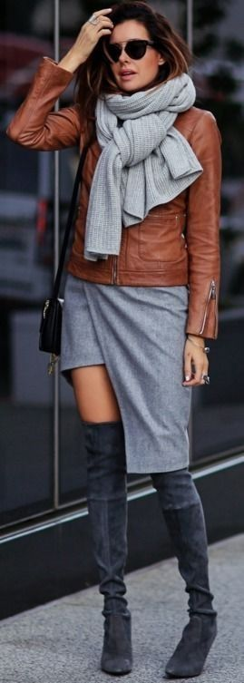 Wearing over the knee boots with an edgy asymmetrical wrap skirt like this one can create an alternative, trendy look. Erica Hoida wears the style with a tan leather jacket and an oversized marl grey scarf.  Jacket: Bernardo, Skirt: Mugler, Shoes: Stuart Weitzman, Scarf: Club Monaco, Bag: Chloe #wearing