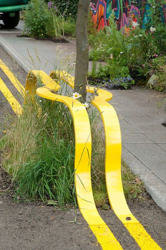 Art everywhere… funny whimsical street art installation yellow lines I have actually seen a piece of road in britain where the road workers took the boss at his word and painted the whole road by going around a car leaving its outline behind, removed after a day of course but very funny