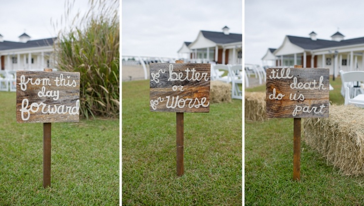 """Signs leading up the aisle at the wedding.  The backside of the signs (on their way out after the ceremony) read """"and they lived happily ever after."""" Cute!"""