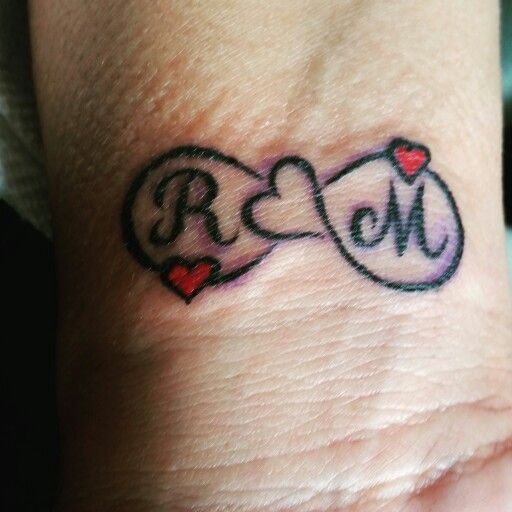 My first tattoo very meaningful kids initials and infinity sign with our hearts.