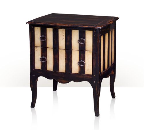A painted bedside chest of drawers, the serpentine top and cabriole legs painted in antiqued noir and ivory, two drawers and sides with striped design. The original French provincial.