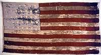 "This is the first American flag to be named ""Old Glory.""  made in 1824 for Captain William Driver  Originally bearing twenty-four stars, the worn and tattered flag was remade in 1861 with thirty-four stars, plus a white anchor to signify Driver's years at sea. When the Civil War began and Tennessee, seceded from the Union, the flag survived, sewn inside a quilt. It was unfurled when Union troops occupied Nashville in 1862. It never flew again, but bequeathed its name to all American flags."